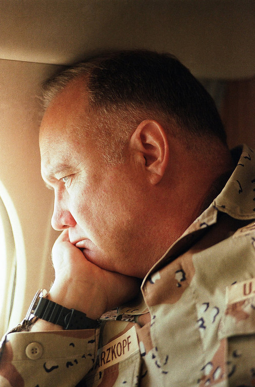 . General H. Norman Schwarzkopf, commander of U.S. troops in the Gulf, gazes from the window of his small jet on his way out to visit U.S. troops in the desert on Saturday, Jan. 13, 1991 in Saudi Arabia. (AP Photo/Bob Daugherty)