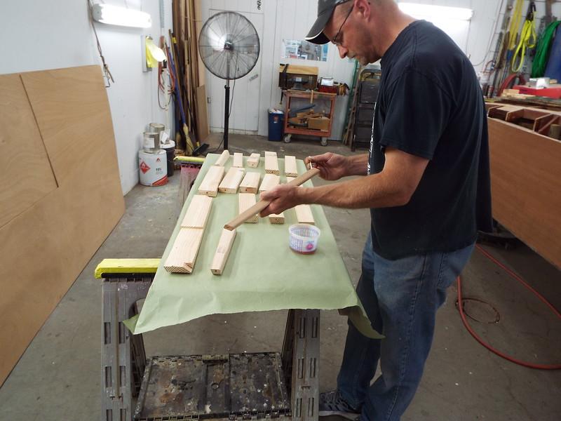 Applying epoxy to the deck blocks.