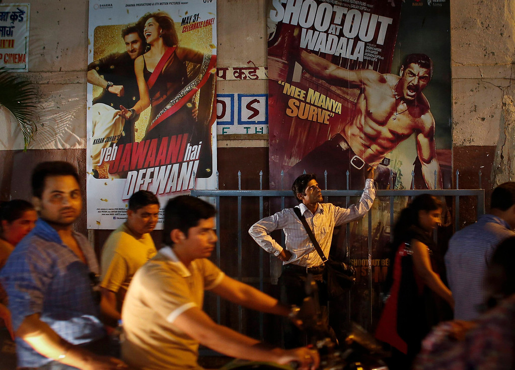 """. Ram Pratap Verma, a 32-year-old aspiring Bollywood film actor, waits outside a cinema after a film screening in Mumbai May 1, 2013. Bollywood is an addiction for many; an addiction that attracts thousands of aspiring stars to the city of Mumbai. Ram Pratap Verma made the journey from his small village eight years ago, and despite carrying his whole \""""home\"""" inside his bag, he is determined not to give up on his ambitions. He endeavours to watch at least one film a week at a cinema, where the silver screen keeps his dreams alive. Picture taken May 1, 2013. REUTERS/Danish Siddiqui"""