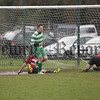 Karl Shields scores a goal in Cleary's 5-0 victory over Rostrevor Rovers. RS1709004