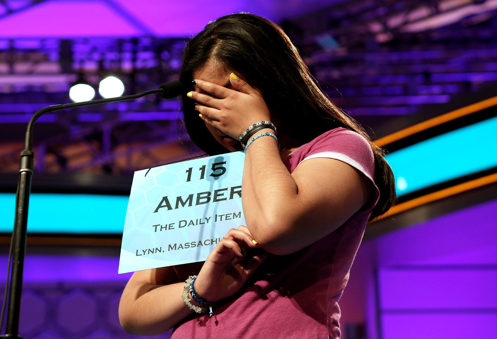 . Amber Born of Lynn, Massachusetts concentrates during the final round of the National Spelling Bee at National Harbor in Maryland May 30, 2013. Arvind Mahankali of New York won the event. REUTERS/Kevin Lamarque