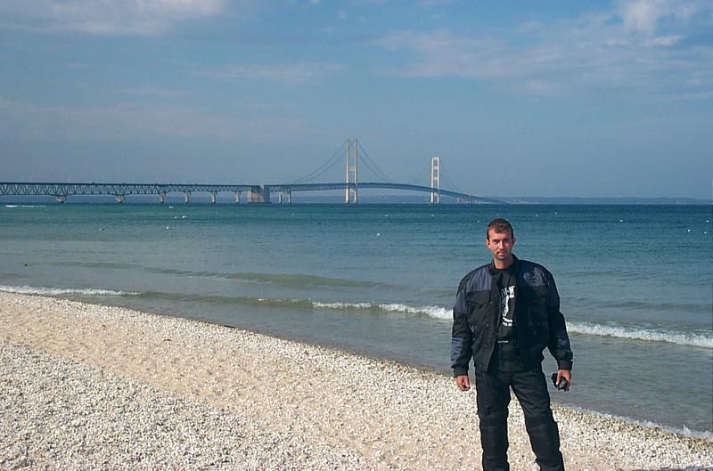 Adam in front of the Mackinac bridge