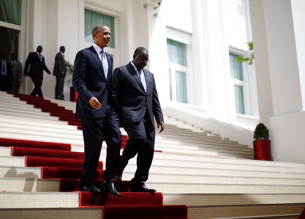. U.S. President Barack Obama (L) arrives at a joint press conference with Senegal\'s President Macky Sall at the Presidential Palace in Dakar, June 27, 2013.   REUTERS/Jason Reed