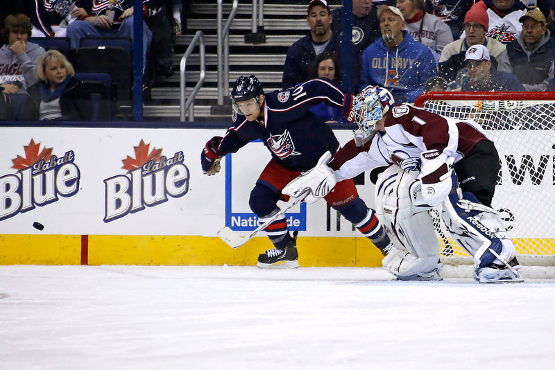 . Semyon Varlamov #1 of the Colorado Avalanche poke checks the puck away from Mark Letestu #10 of the Columbus Blue Jackets during the first period on March 3, 2013 at Nationwide Arena in Columbus, Ohio. (Photo by Kirk Irwin/Getty Images)