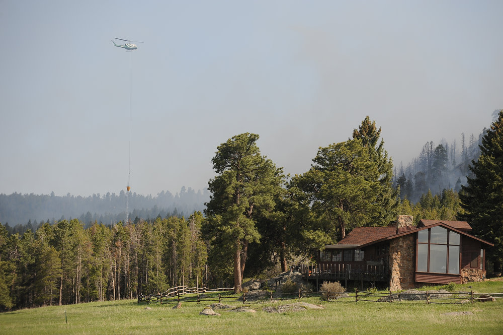 . WIldfire near Evergreen, Colorado. A fire started early in the afternoon on June 3, 2013 and by 3:30 p.m., residents of the surrounding area were told to evacuate. (Photo By Steve Nehf / The Denver Post)