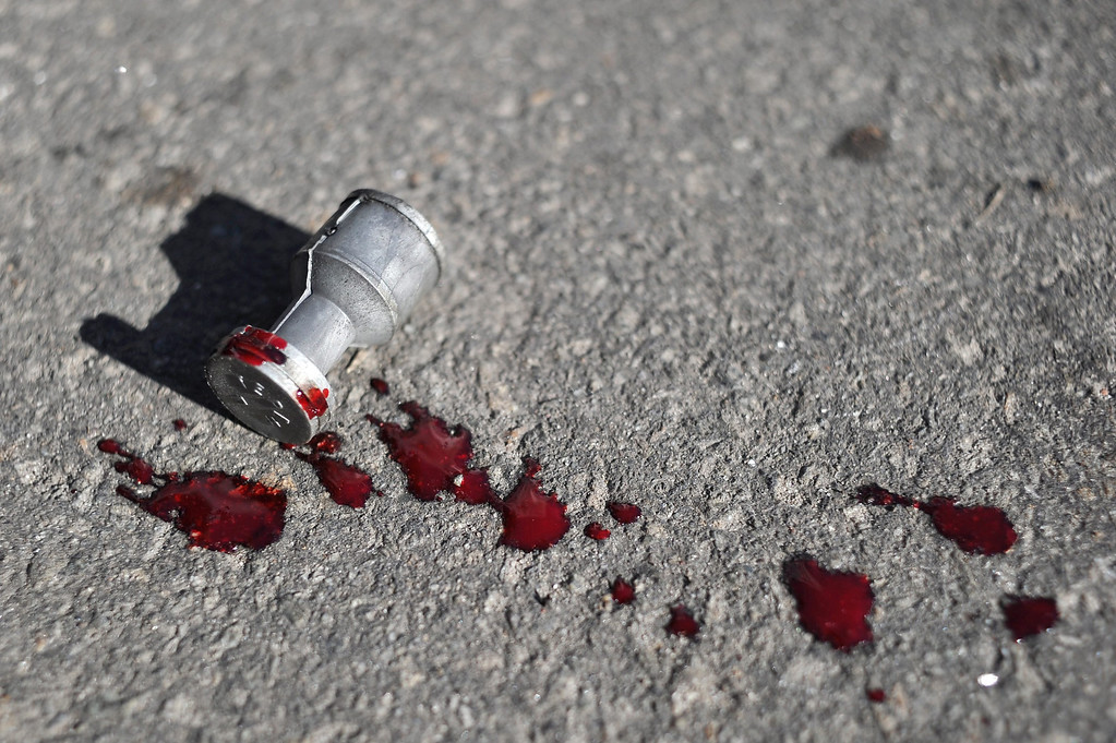 . A bullet used by the riot police lies on the floor with blood on it during an anti-government protest in downtown Kiev, Ukraine, 18 February 2014.  EPA/ALEXEY FURMAN