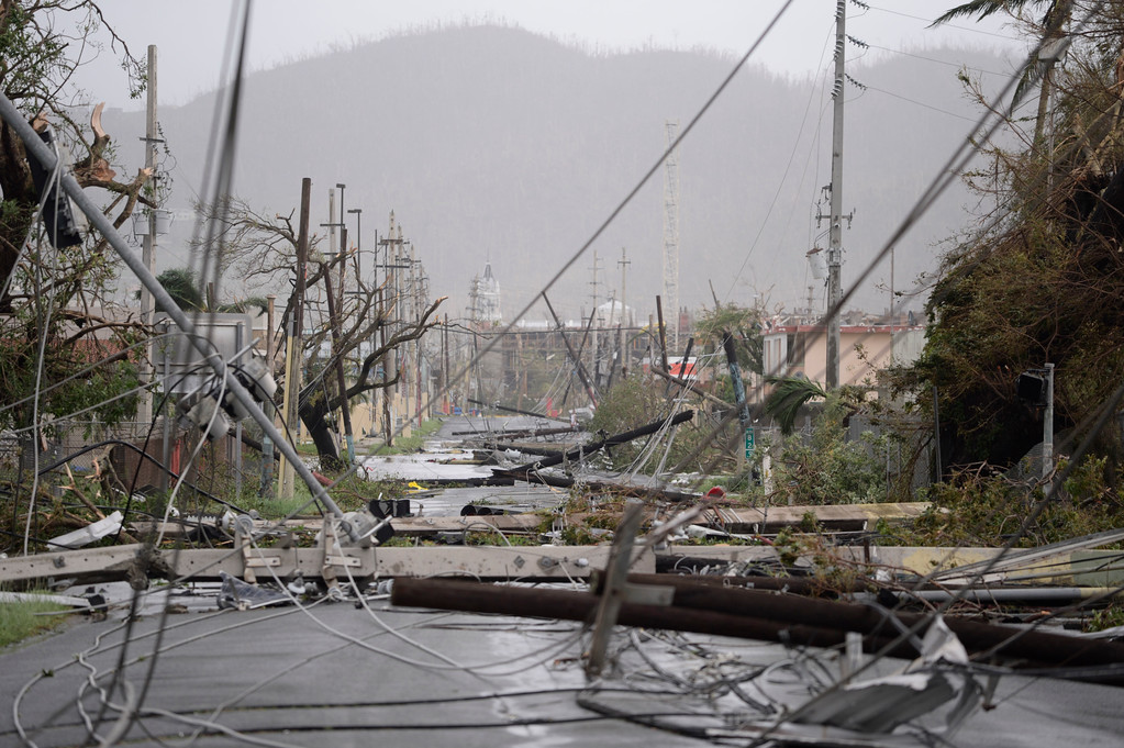 . Electricity poles and lines lay toppled on the road after Hurricane Maria hit the eastern region of the island, in Humacao, Puerto Rico, Wednesday, Sept. 20, 2017. The strongest hurricane to hit Puerto Rico in more than 80 years destroyed hundreds of homes, knocked out power across the entire island and turned some streets into raging rivers in an onslaught that could plunge the U.S. territory deeper into financial crisis. (AP Photo/Carlos Giusti)
