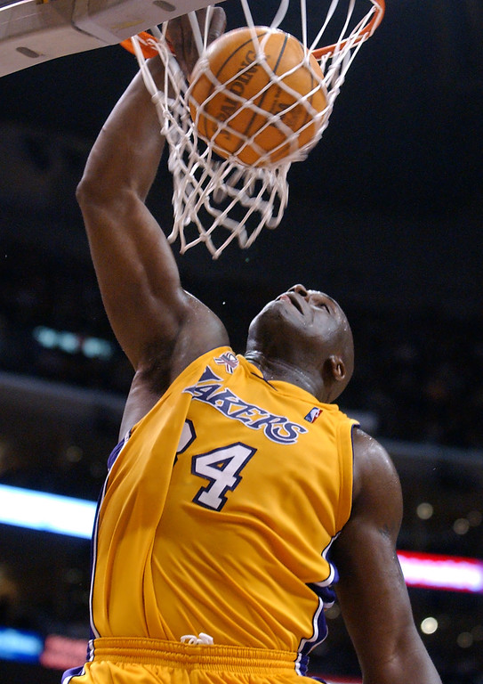 . Los Angeles Lakers\' Shaquille O\'Neal dunks against the Detroit Pistons in the second half in Los Angeles, Friday, March 22, 2002.  The Lakers won 94-82, and O\'Neal was the high scorer with 28 points. (AP Photo/Lucy Nicholson)