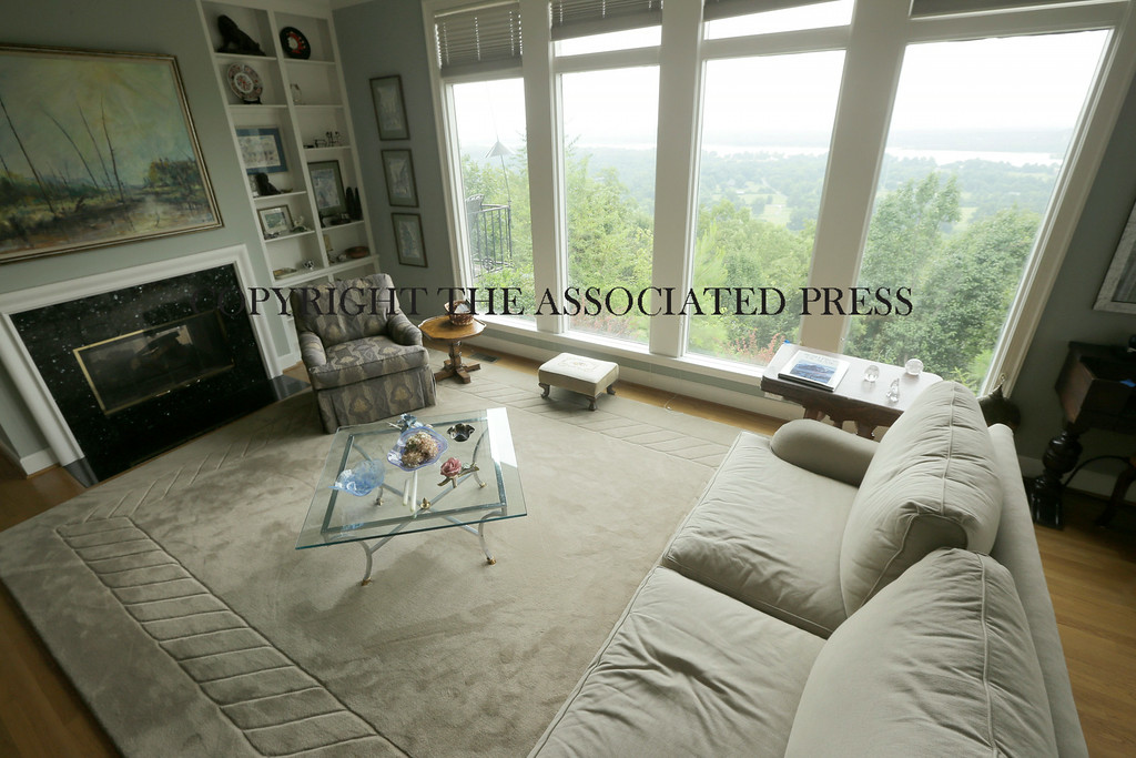 . This is an interior view of the living room at a home for sale listed at $999,500 that is located on 5 acres of land overlooking the Arkansas River valley on Wednesday, July 30, 2014, in Little Rock, Ark. (AP Photo/Danny Johnston)