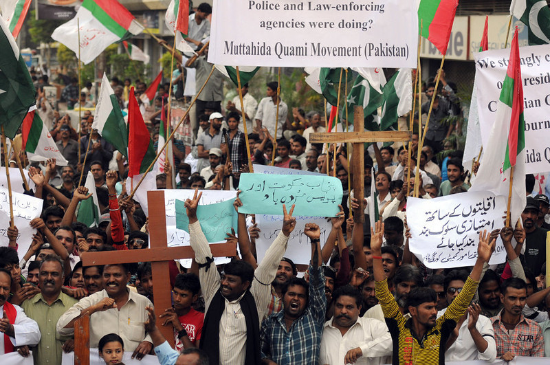 . Pakistani Christians shout slogans during a protest against the attack on the homes of members of the Christian community by Muslim demonstrators, in Karachi on March 10, 2013. A drunken row between two friends was the trigger for blasphemy allegations that prompted a mob of angry Pakistani Muslim protesters to burn more than 100 Christian homes, police and witnesses said. More than 3,000 Muslims rampaged through Joseph Colony, a Christian area of the eastern city of Lahore, on March 9 after allegations that a Christian had made derogatory remarks about the Prophet Mohammed three days earlier.   ASIF HASSAN/AFP/Getty Images