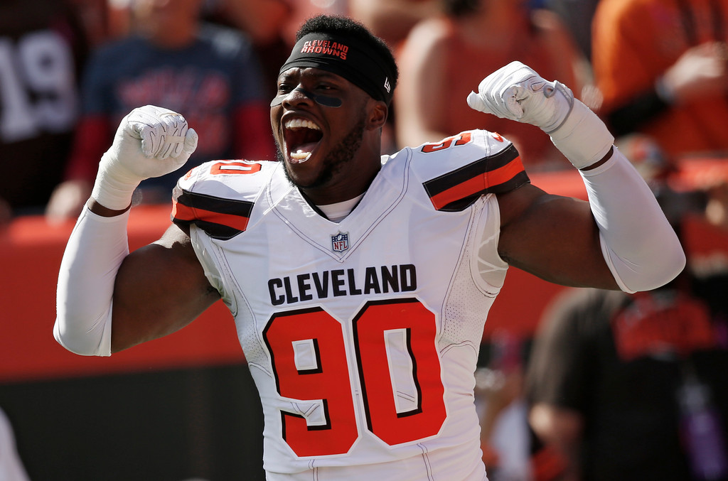 . Cleveland Browns defensive end Emmanuel Ogbah reacts during introductions before an NFL football game between the New York Jets and the Cleveland Browns, Sunday, Oct. 8, 2017, in Cleveland. (AP Photo/Ron Schwane)