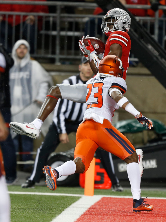 . Ohio State receiver Binjimen Victor, top, catches a touchdown against Illinois defensive back Frank Sumpter during the second half of an NCAA college football game Saturday, Nov. 18, 2017, in Columbus, Ohio. (AP Photo/Jay LaPrete)