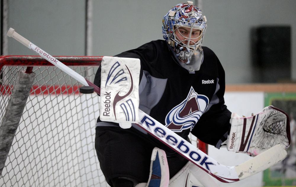 . Colorado Avalanche G Semyon Varlamov (1) blocks a shot during practice Wednesday, January 16, 2013 at Family Sports Center. John Leyba, The Denver Post