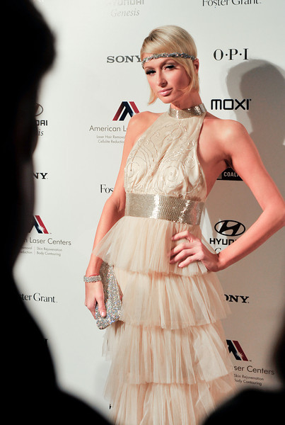 """Photograph of Paris Hilton dressed as flapper attending Oscar Party with IS VODKA www.ISVodka.com and  fashion show featuring  Russel Simmons new clothes line """"Argyle Culture."""""""