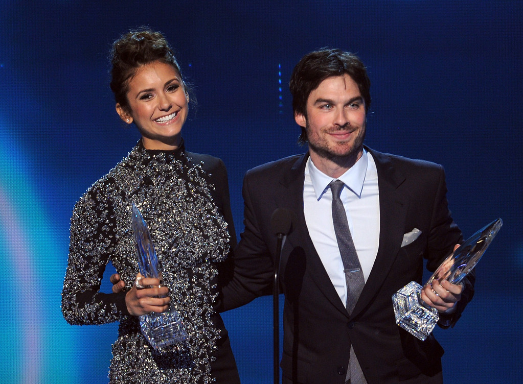 ". LOS ANGELES, CA - JANUARY 08:  Actors Nina Dobrev (L) and Ian Somerhalder, winners of the Favorite On Screen Chemistry award for ""The Vampire Diaries,\"" speak onstage at The 40th Annual People\'s Choice Awards at Nokia Theatre L.A. Live on January 8, 2014 in Los Angeles, California.  (Photo by Kevin Winter/Getty Images)"