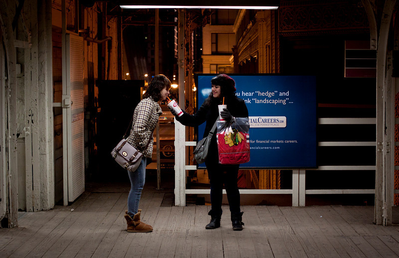Some girls share a slurpie at a Metra stop in Chicago, Illinois on February 19, 2011.  (Jay Grabiec)