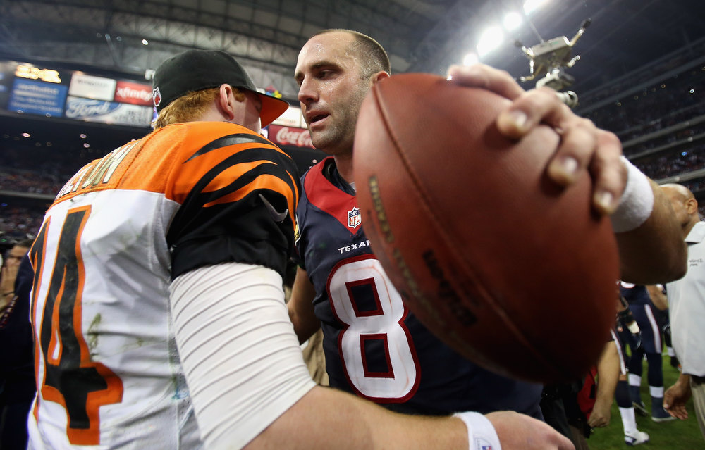 Description of . Matt Schaub #8 of the Houston Texans hugs Andy Dalton #14 of the Cincinnati Bengals after a 19-13 win during the AFC Wild Card Playoff Game at Reliant Stadium on January 5, 2013 in Houston, Texas.  (Photo by Ronald Martinez/Getty Images)