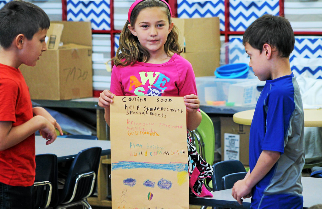 . Kristi Garabrandt � The News-Herald <br> Armin Bundavica, Mackenzie Roberts and Dominic Quinones, second grade students at Longfellow Elementary Schools present the poster worked on as a team for a project based learning experience to help promote The Miracle League of Lake County.