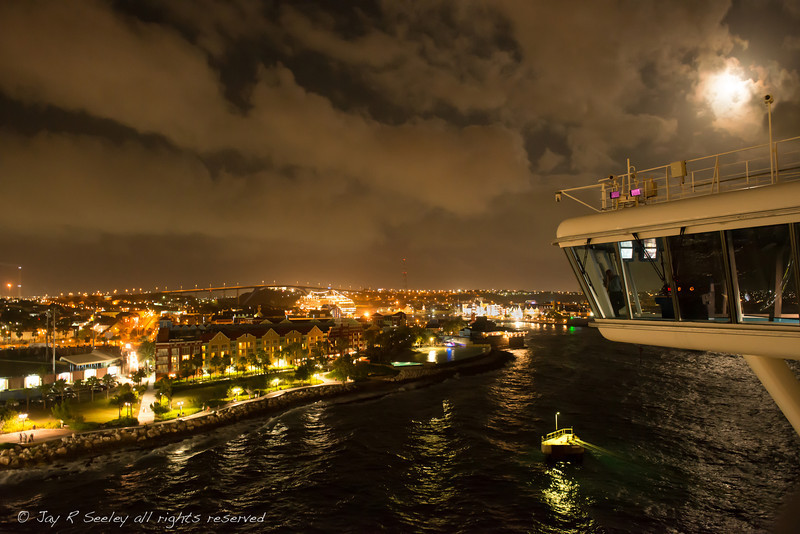 Curacao at night from the Caribbean Princess. The large structure to the right in the picture is the port side navigation bridge on the Caribbean Princess.