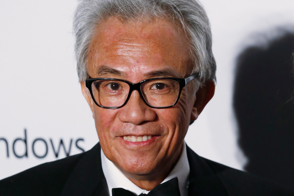 . In this Saturday, March 14, 2015, photo, Hong Kong businessman and socialite David Tang, poses on the red carpet for the fundraising gala organized by amfAR (The Foundation for AIDS Research) in Hong Kong. Tang, a flamboyant and outspoken socialite and entrepreneur who founded the Shanghai Tang fashion brand, died Aug. 29. He was 63. (AP Photo/Kin Cheung)