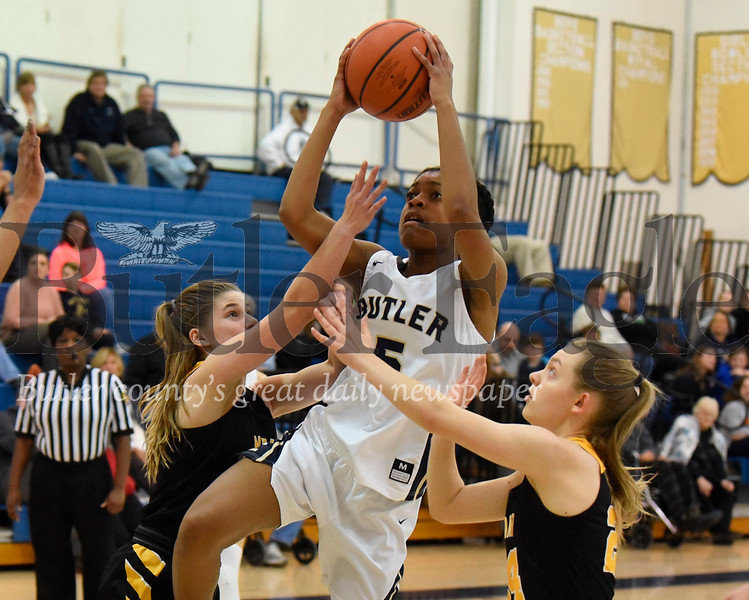 Butler's Sarayne Forbes #5 hits a layup over North Allegheny's  Abby Glass #24 (right) and  Biz Watson #13 in Thursday night's home game. Seb Foltz/Butler Eagle