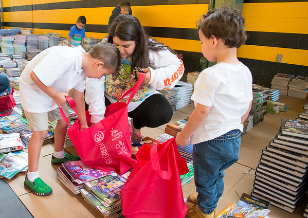 09/04/19 Wesley Bunnell | StaffrrTwenty two thousand books were donated to area educators and parents with children by ESPN and Disney on Thursday September 4, 2019 at New Britain Stadium. Dayanara Gonzalez helps her sons Noah Morales, L, and Isaac Morales choose books to bring home.