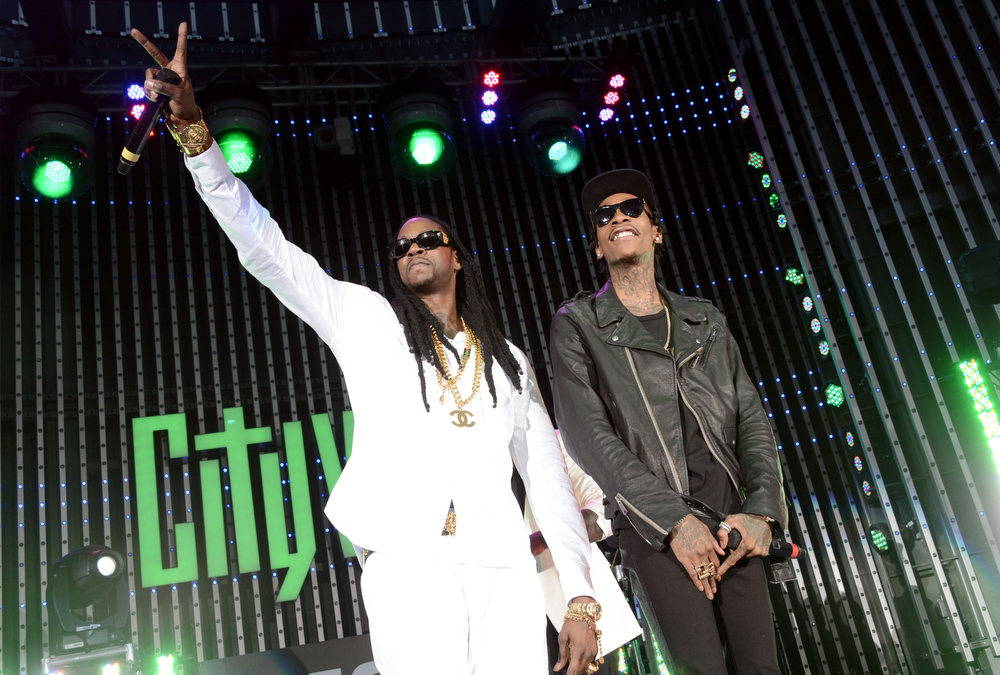 """. Rappers 2 Chainz and Wiz Khalifa perform at the premiere of Universal Pictures\' \""""Fast & Furious 6\"""" at Gibson Amphitheatre on May 21, 2013 in Universal City, California.  (Photo by Kevin Winter/Getty Images)"""