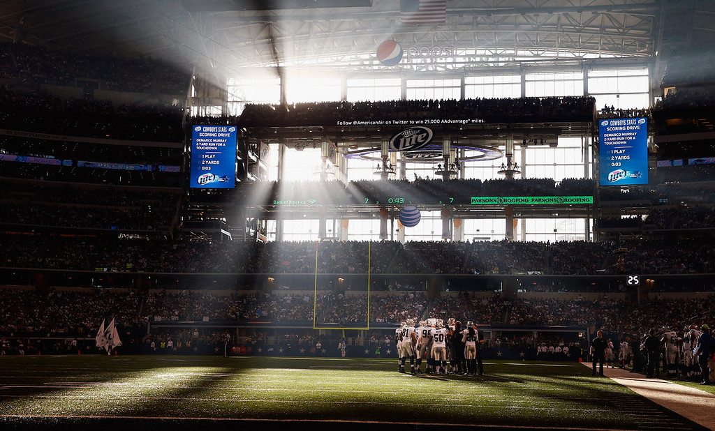 . The Oakland Raiders huddle up against the Dallas Cowboys during a Thanksgiving Day game at AT&T Stadium on November 28, 2013 in Arlington, Texas.  (Photo by Tom Pennington/Getty Images)