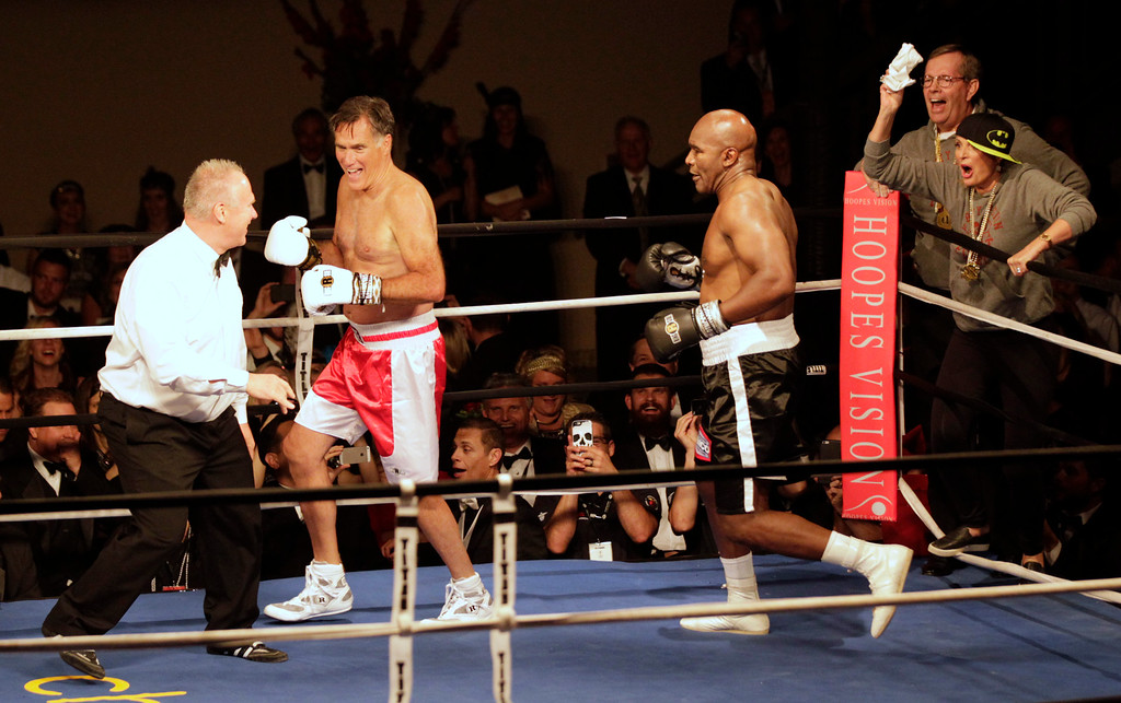 ". Mitt Romney runs from Evander Holyfield after knocking him down during a fight in a charity boxing event on May 15, 2015 in Salt Lake City, Utah. The event was held to raise money for  ""Charity Vision\"" a charity that aims to restore sight to the blind and visually impaired. (Photo by George Frey/Getty Images)"