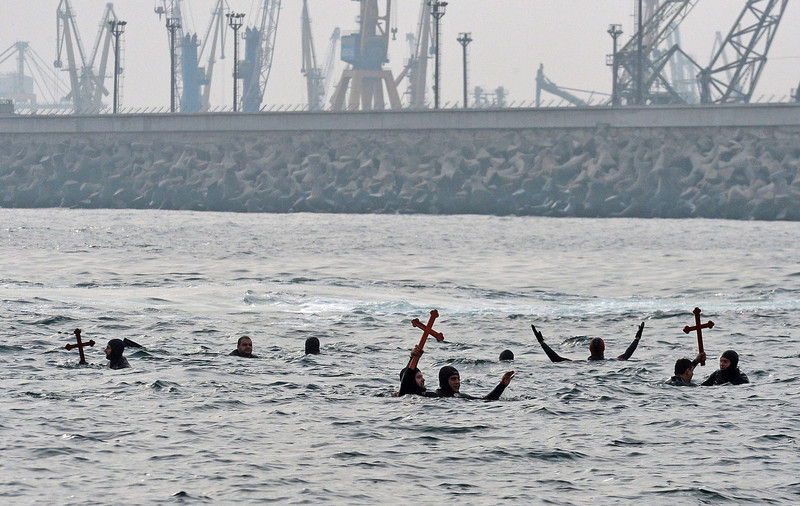 . Romanians hold wooden crosses thrown by an Orthodox priest in the waters of the Black Sea during Epiphany celebrations in Constanta, 250 km east from Bucharest, on January 6, 2014.  DANIEL MIHAILESCU/AFP/Getty Images
