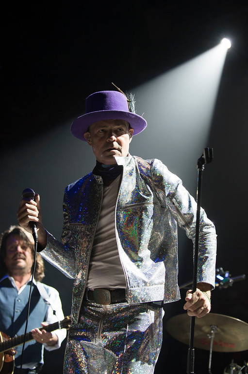 . FILE - In this Aug. 10, 2016 file photo, Gord Downie, singer and songwriter of Canadian rock band The Tragically Hip, performs in Toronto, Canada. The widely revered lead singer died Tuesday night, Oct. 17, 2017. He was 53. (Photo by Arthur Mola/Invision/AP File)