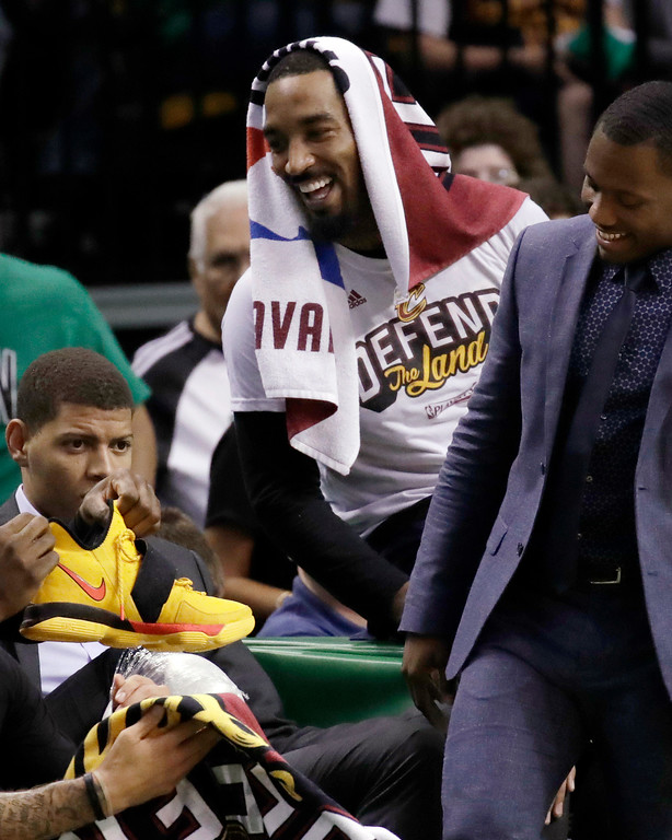 . Cleveland Cavaliers guard J.R. Smith, right, shares a light moment with teammates on the bench during the second half of Game 2 of the NBA basketball Eastern Conference finals against the Boston Celtics, Friday, May 19, 2017, in Boston. (AP Photo/Elise Amendola)