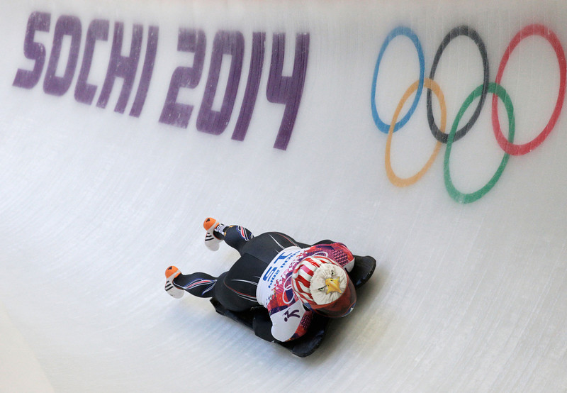 . Katie Uhlaender of the United States makes a run during the Women\'s Skeleton heats on Day 6 of the Sochi 2014 Winter Olympics at Sliding Center Sanki on February 13, 2014 in Sochi, Russia.  (Photo by Adam Pretty/Getty Images)