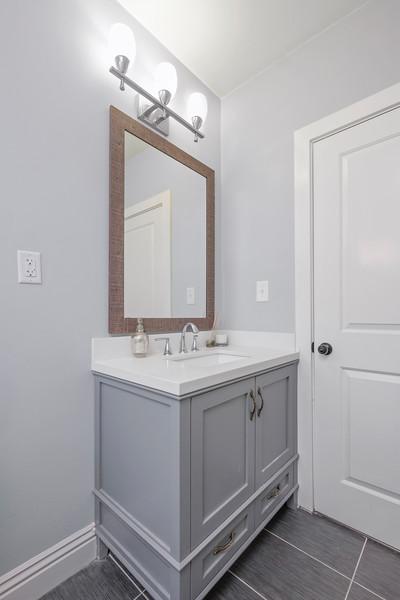 Bathroom right most light bulb (1).jpg