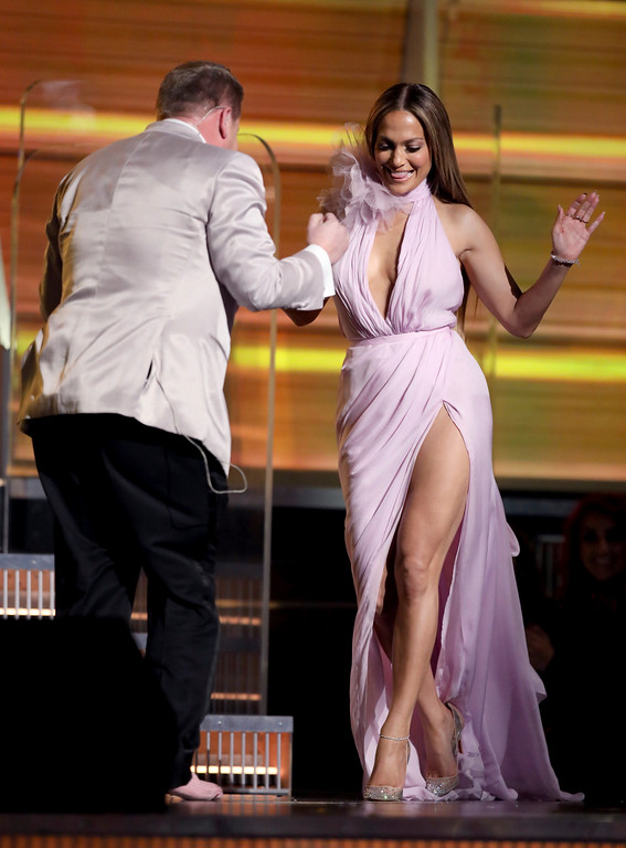 . James Corden, left, helps Jennifer Lopez walk onstage at the 59th annual Grammy Awards on Sunday, Feb. 12, 2017, in Los Angeles. (Photo by Matt Sayles/Invision/AP)