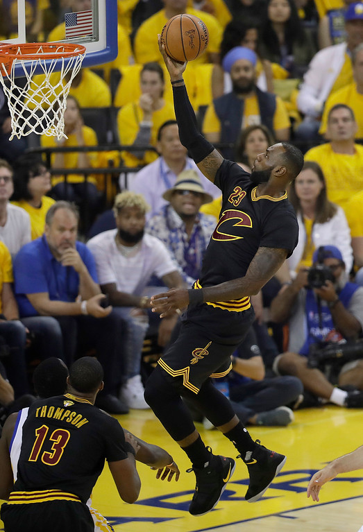 . Cleveland Cavaliers forward LeBron James (23) shoots against the Golden State Warriors during the first half of Game 2 of basketball\'s NBA Finals in Oakland, Calif., Sunday, June 4, 2017. (AP Photo/Marcio Jose Sanchez)