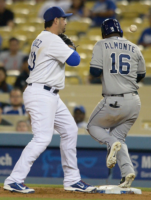 . Padres Abraham Almonte beats a ball to first base when Adrian Gonzalez can\'t get to the throw in the 9th inning. The Dodgers defeated the San Diego Padres 8-6 at Dodger Stadium. Los Angeles, CA. 8/19/2014(Photo by John McCoy Daily News)