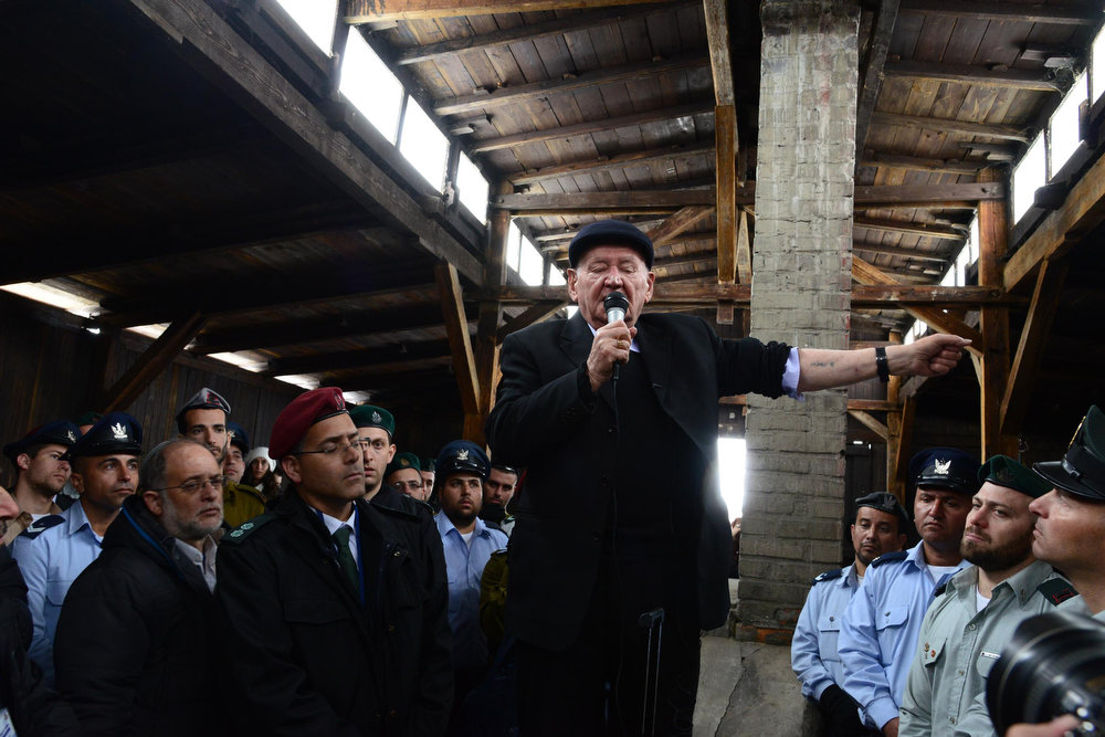 ". A holocaust survivor speaks during the ""March of the Living\"" ceremonies at the site of the Auschwitz concentration camp on April 7, 2013 in Oswiecim, Poland. Israeli Defense Force Chief of the General Staff Benny Gantz will be one of the six torch lighters at the ceremony that closes the program. (Photo by Moshe Milner/GPO via Getty Images)"