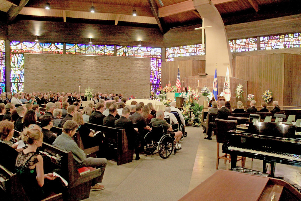 . Family and friends of Mendota Heights police officer Scott Patrick listen during his funeral service at St. Stephen\'s Lutheran Church in West St. Paul on Wednesday.  (Minnesota Department of Public Safety Pool Photo: Jen Longaecker)