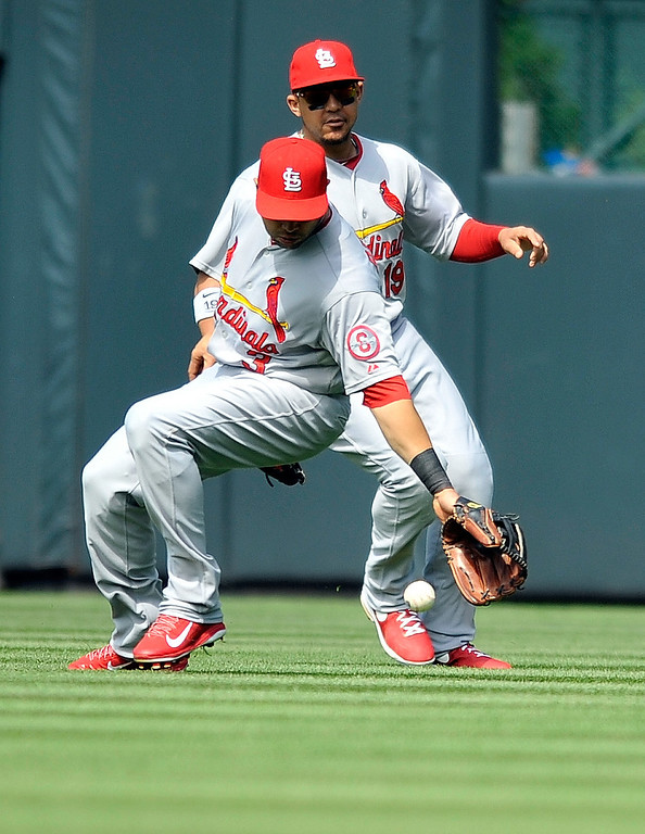 . St. Louis Cardinals right fielder Carlos Beltran (3) and Jon Jay (19) drop a fly ball hit by Colorado Rockies\' Charlie Culberson  during the second inning of a baseball game on Thursday, Sept. 19, 2013, in Denver. (AP Photo/Jack Dempsey)