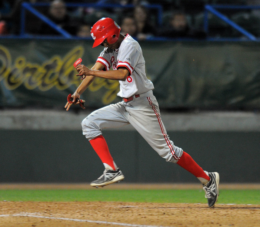 . LONG BEACH - 04/24/13 - (Photo: Scott Varley, Los Angeles Newspaper Group)  Long Beach Poly vs Lakewood in a Moore League baseball game at Blair Field. Lakewood\'s Tyler McClure scores in the 6th innning on a sacrifice fly by Kyle Clary.