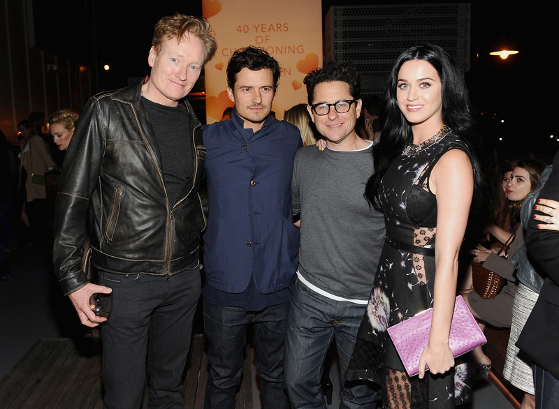 . TV personality Conan O\'Brien, actor Orlando Bloom, host J.J. Abrams and singer Katy Perry attend Coach\'s 3rd Annual Evening of Cocktails and Shopping to Benefit the Children\'s Defense Fund hosted by Katie McGrath, J.J. Abrams and Bryan Burk at Bad Robot on April 10, 2013 in Santa Monica, California.  (Photo by Stefanie Keenan/Getty Images for Coach)