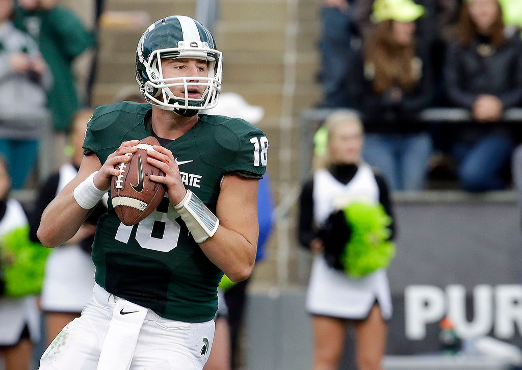 . Michigan State quarterback Connor Cook looks to pass while playing Purdue in the second half of an NCAA college football game in West Lafayette, Ind., Saturday, Oct. 11, 2014. Michigan State won 45-31. (AP Photo/AJ Mast)