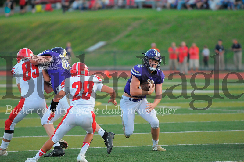 Karns City #2 Anthony Kamenski does a quarterback keeper as Punxsutawney #28 Max London goes for the block during a game at Deihl Stadium on Friday August 30, 2019 (Jason Swanson photo)