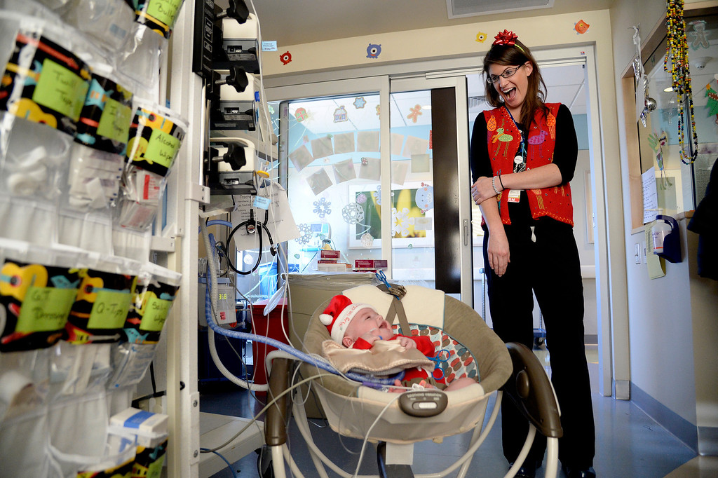. AURORA, CO - DECEMBER 25: Nurse Sarah Hodgin visits baby Aiden Schmitt during her shift in the NICU. Nurses and other hospital staff work on Christmas day at Children\'s Hospital on Wednesday, December 25, 2013. (Photo by AAron Ontiveroz/The Denver Post)