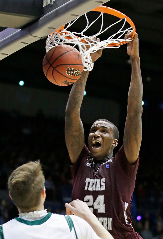 . Texas Southern center Aaric Murray (24) dunks against Cal Poly in the second half of a first-round game of the NCAA college basketball tournament on Wednesday, March 19, 2014, in Dayton, Ohio. (AP Photo/Al Behrman)