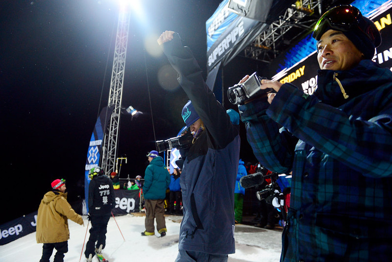 . ASPEN, CO. - JANUARY 24: Elana Chase gives her rider Annalisa Drew  a fist in their air for a job well done during warmup for the women\'s ski superpipe final. X Games Aspen Buettermilk Mountain Aspen January 25, 2013 (Photo By AAron Ontiveroz / The Denver Post)