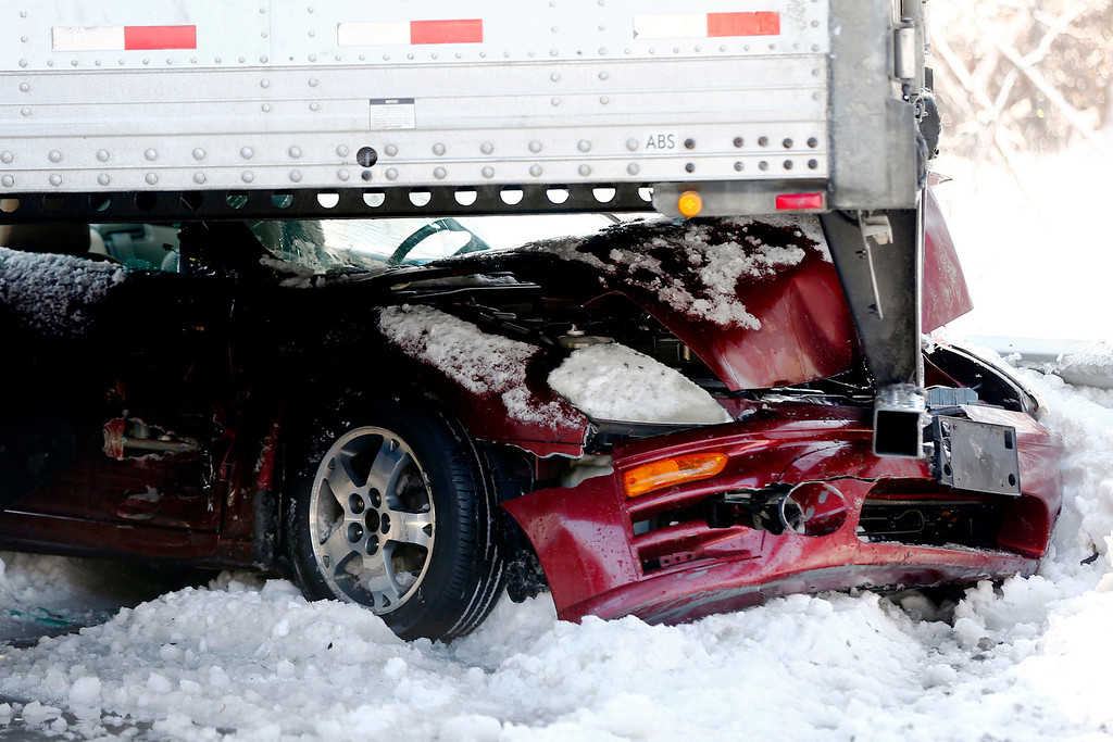 . Vehicles are piled up in an accident, Friday, Feb. 14, 2014, in Bensalem, Pa. Traffic accidents involving multiple tractor-trailers and dozens of cars have completely blocked one side of the Pennsylvania Turnpike outside Philadelphia and caused some injuries. (AP Photo/Matt Rourke)