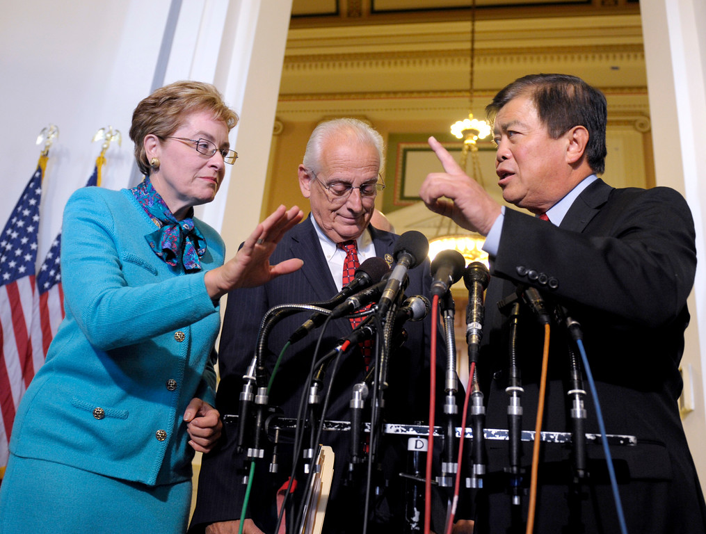 . From left, Rep. Marcy Kaptur, D-Ohio, Rep. Bill Pascrell, D-N.Y., and David Wu, D-Ore., speak over each other, on Capitol Hill in Washington, Wednesday, Nov. 17, 2010, as they try to respond to a question as House Democrats met to elect their leaders for the next Congress. (AP Photo/Susan Walsh)