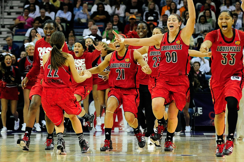 . Members of the Louisville Cardinals celebrate a victory over the California Golden Bears during the National Semifinal game of the 2013 NCAA Division I Women\'s Basketball Championship at New Orleans Arena on April 7, 2013 in New Orleans, Louisiana. (Photo by Stacy Revere/Getty Images)